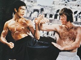 Picture of Chuck Norris giving Bruce Lee a training lesson.